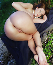 Sexy brunette nude outdoors